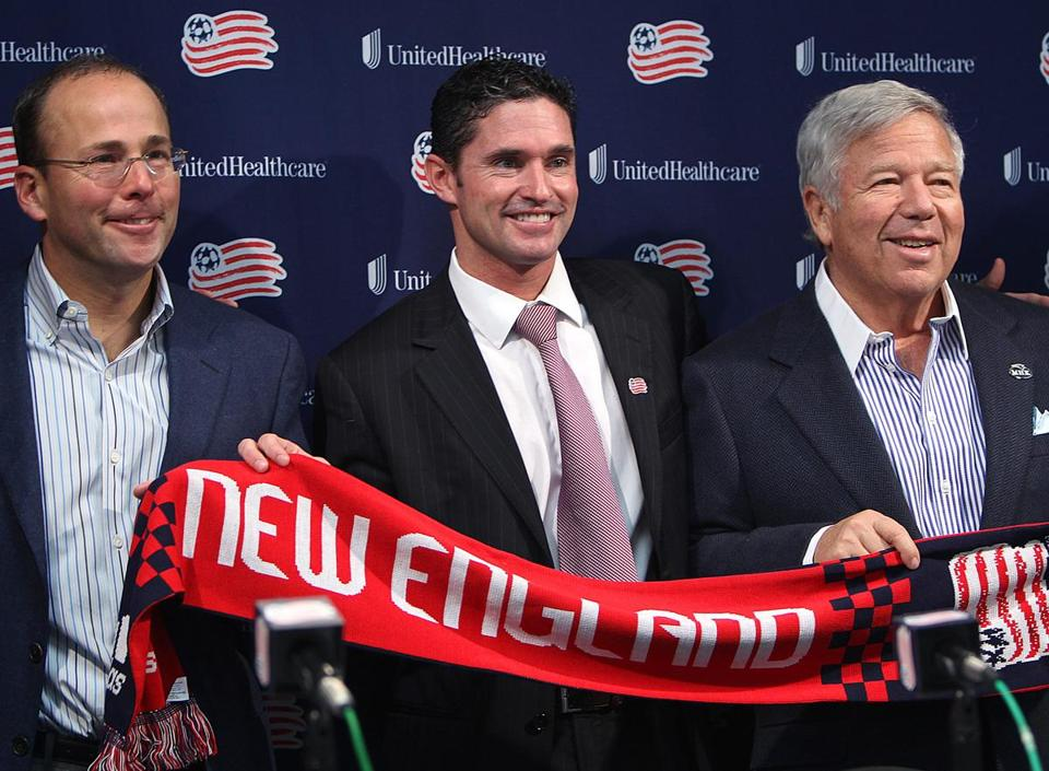 Jonathan Kraft, left, and Robert Kraft introduced Jay Heaps as the Revolution's new coach yesterday.